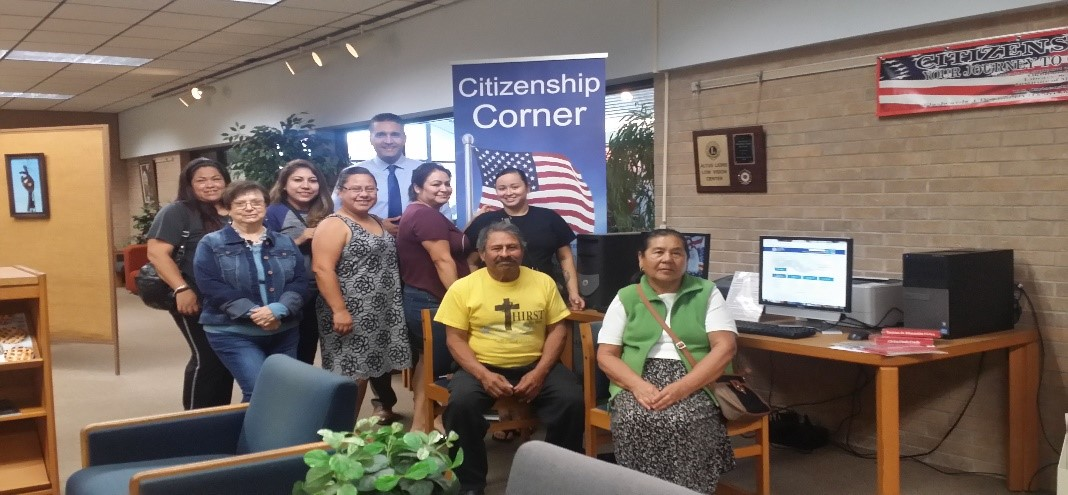 Family celebrating citizenship at the library