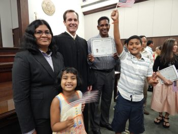 A family celebrating citizenship
