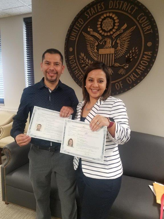 A couple celebrates their citizenship